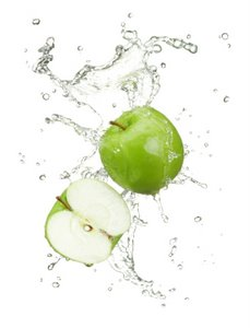 fresh green apples in a splash of water