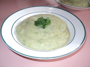 steaming hot potato soup with parsley