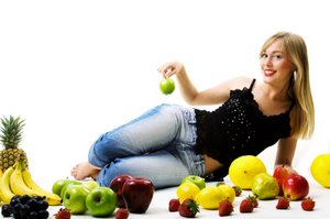 woman reclining amongst delicious fruit