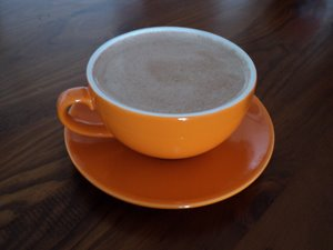 raw coffee in orange cup