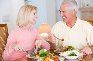 man and woman enjoying a healthy meal
