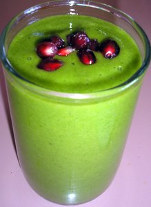 green smoothie with pomegranate seeds