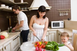 family preparing a healthy salad