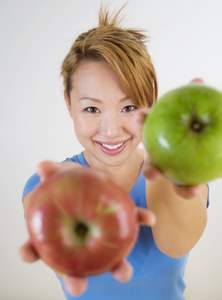 healthy eating woman offering apples