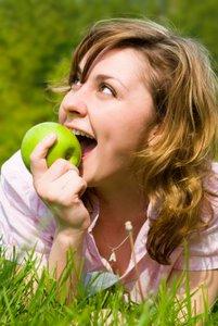 woman enjoying eating apple