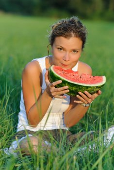 woman enjoying eating a watermelon