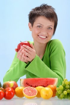 healthy woman eating fruit